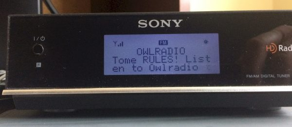 "picture of the Sony tuner displaying the RDS received data ""OWLRULES"" and ""Tome RULES! Listen to Owlradio"""